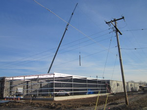 Large Crane at Premold Corp'.'s Building Expansion
